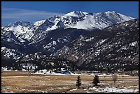 Thawing meadow and snowy peaks, late winter. Rocky Mountain National Park, Colorado, USA. (color)