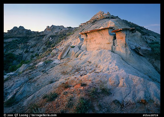 Badlands and caprock formation at sunset, South Unit. Theodore Roosevelt National Park, North Dakota, USA.