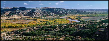 Wide valley with river and aspens in autumn color. Theodore Roosevelt National Park (Panoramic color)
