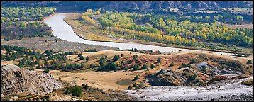 River, badlands, and aspens in the fall. Theodore Roosevelt National Park, North Dakota, USA.