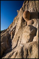 Cannonball concretions on cliff. Theodore Roosevelt National Park, North Dakota, USA. (color)