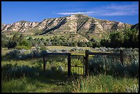 Fence around ranch house site, Elkhorn Ranch Unit. Theodore Roosevelt National Park, North Dakota, USA. (color)
