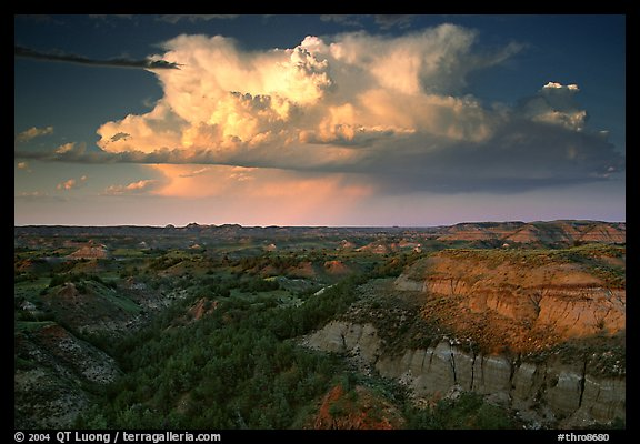 Storm cloud and badlands at sunset, outh Unit. Theodore Roosevelt National Park, North Dakota, USA.