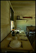 Dining table inside Roosevelt's Maltese Cross Cabin. Theodore Roosevelt National Park, North Dakota, USA.