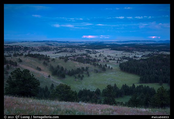 Rolling hills with distant lightening storm at dusk. Wind Cave National Park (color)