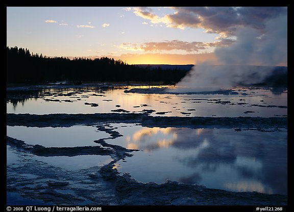 Great Fountain Geyser with residual steam at sunset. Yellowstone National Park (color)