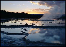 Great Fountain Geyser with residual steam at sunset. Yellowstone National Park, Wyoming, USA.