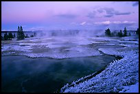 West Thumb Geyser Basin covered by snow at dusk. Yellowstone National Park, Wyoming, USA. (color)