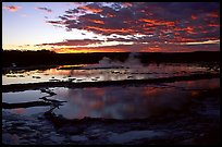 Great Fountain geyser and colorful clouds at sunset. Yellowstone National Park, Wyoming, USA.