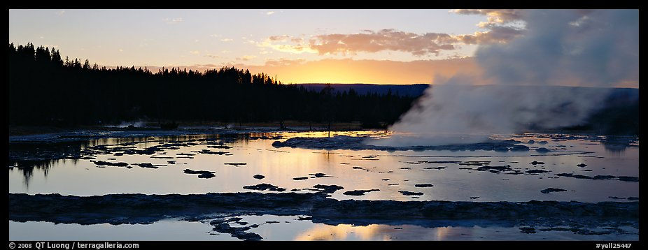 Steam rising in geyser pool at sunset. Yellowstone National Park (color)