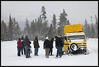 Travelers boarding snow bus. Yellowstone National Park, Wyoming, USA. (color)
