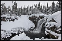 Snowy landscape with waterfall. Yellowstone National Park, Wyoming, USA.