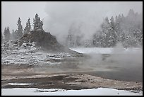 Castle geyser cone and steam in winter. Yellowstone National Park, Wyoming, USA. (color)