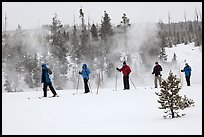 Skiers and thermal steam. Yellowstone National Park ( color)