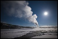 Old Faithful Geyser eruption and moon. Yellowstone National Park, Wyoming, USA.