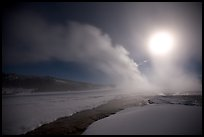 Run-off and geyser, steam obscuring moon, Old Faithful. Yellowstone National Park, Wyoming, USA.