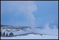 Old Faithful geyser plume in winter. Yellowstone National Park, Wyoming, USA.