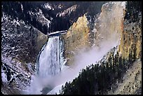 Mist raising from falls of the Yellowstone river. Yellowstone National Park, Wyoming, USA.