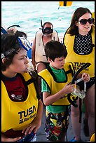 Family preparing for snorkeling. Biscayne National Park, Florida, USA. (color)