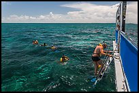 Snorkeling boat, snorklers and reef. Biscayne National Park, Florida, USA. (color)