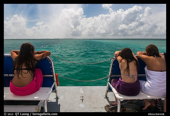 Women sunning themselves on snorkeling boat. Biscayne National Park (color)