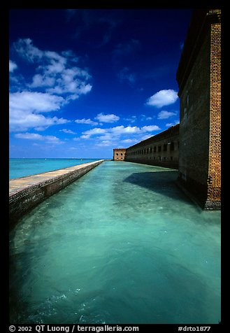 Fort Jefferson moat and massive brick wall on a sunny dayl. Dry Tortugas National Park, Florida, USA.