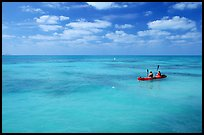 Sea kayakers in turquoise waters. Dry Tortugas National Park, Florida, USA. (color)
