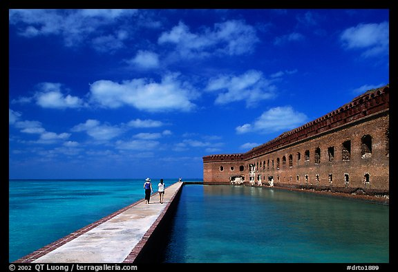 Visitors stroll on the seawall. Dry Tortugas National Park, Florida, USA.