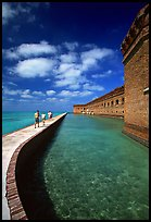 Tourists walking on seawall. Dry Tortugas National Park, Florida, USA. (color)