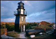 Lighthouse and cannon on upper level of Fort Jefferson. Dry Tortugas National Park, Florida, USA.