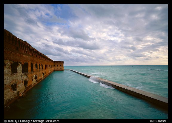 Fort Jefferson wall and moat with wave over seawall, cloudy weather. Dry Tortugas  National Park (color)