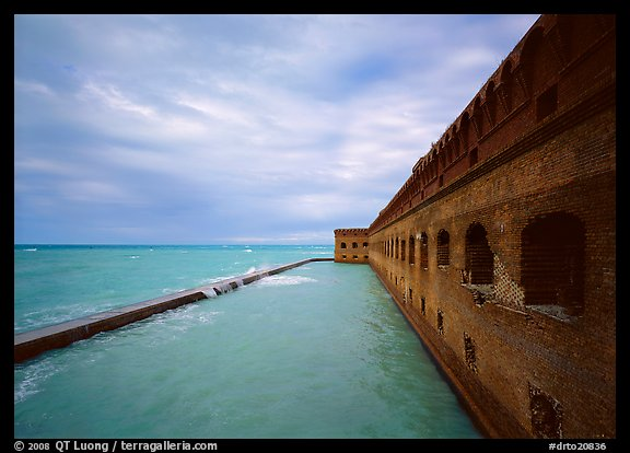 Fort Jefferson massive brick wall overlooking the ocean, cloudy weather. Dry Tortugas National Park (color)