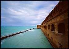 Fort Jefferson massive brick wall overlooking the ocean, cloudy weather. Dry Tortugas National Park, Florida, USA.