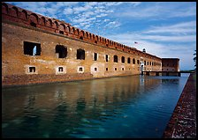 Fort Jefferson moat, walls and lighthouse. Dry Tortugas National Park, Florida, USA.