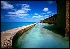Moat with turquoise waters, seawall, and fort. Dry Tortugas National Park, Florida, USA.