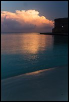 Beach, cloud and fort at sunrise. Dry Tortugas National Park ( color)