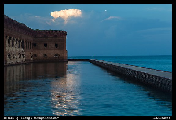 Moat, fort, bright cloud at dawn. Dry Tortugas National Park (color)