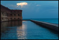 Moat, fort, bright cloud at dawn. Dry Tortugas National Park ( color)