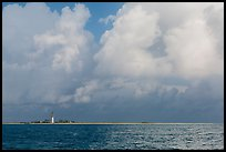 Loggerhead key and lighthouse under tropical clouds. Dry Tortugas National Park, Florida, USA. (color)