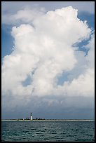 Loggerhead key and lighthouse and tropical cloud. Dry Tortugas National Park, Florida, USA. (color)