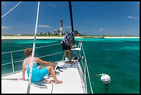 Sailors hooking mooring buoy at Loggerhead Key. Dry Tortugas National Park, Florida, USA. (color)