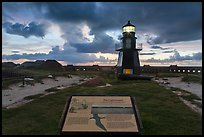 Interpretive sign, Harbor Light, and fort Jefferson. Dry Tortugas National Park, Florida, USA. (color)
