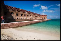 Park visitor looking, North Beach and Fort Jefferson. Dry Tortugas National Park, Florida, USA. (color)