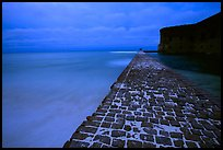 Brick seawall at dusk during a storm. Dry Tortugas National Park, Florida, USA. (color)