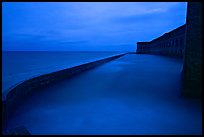 Seawall at dusk during  storm. Dry Tortugas National Park, Florida, USA. (color)