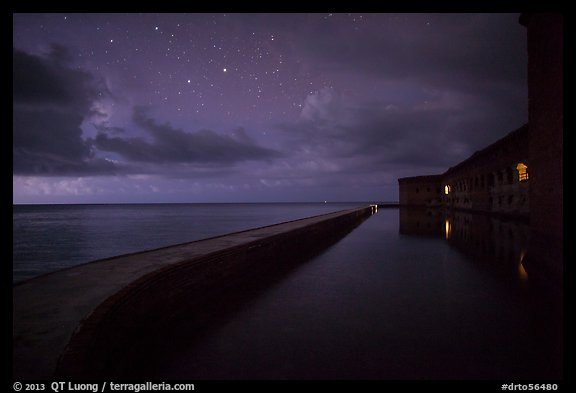 Fort Jefferson at night with stars and light from storm. Dry Tortugas National Park (color)