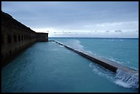 Seawall and moat with waves on stormy day. Dry Tortugas National Park, Florida, USA.