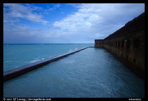 Seascape with fort seawall and moat on cloudy day. Dry Tortugas National Park (color)