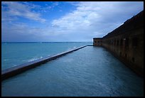 Seascape with fort seawall and moat on cloudy day. Dry Tortugas National Park, Florida, USA. (color)