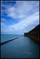 Sky, seawall and moat on windy day. Dry Tortugas National Park, Florida, USA. (color)